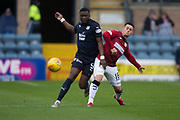 18th May 2019, Dens Park, Dundee, Scotland; Ladbrokes Premiership football, Dundee versus St Mirren; Genserix Kusunga of Dundee challenges for the ball with Danny Mullen of St Mirren