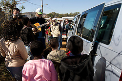 Guitarist Igor Leonardi, photographer Drago Wernig Taka visiting poor black people on June 18, 2010 in Soweto, part of Johannesburg, South Africa. (Photo by Vid Ponikvar / Sportida)