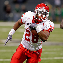 Oct 17, 2009; New Orleans, LA, USA;  Houston Cougars running back Chris Wilson (26) runs with the ball during a game against the Tulane Green Wave at the Louisiana Superdome. Houston defeated Tulane 44-16.   Mandatory Credit: Derick E. Hingle-US PRESSWIRE