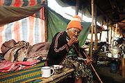 Kachin refugee housewives ai Je Yang Hka near China Myanmar boarder Lai Za, A deaft refugee granny having dinner on her own.