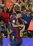 FC Barcelona's Leo Messi (t) and Xavi Hernandez (d) celebrate goal during the Supercup of Spain.August 23 2009.