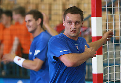Luka Zvizej of Slovenia (at left Bostjan Kavas) before  handball game between men national teams of Slovenia and Slovakia, first qualification game for the World Chamionship 2009, on June 7, 2008, in Arena Zlatorog, Celje, Slovenija. Result: 33 : 33. (Photo by Vid Ponikvar / Sportal Images)