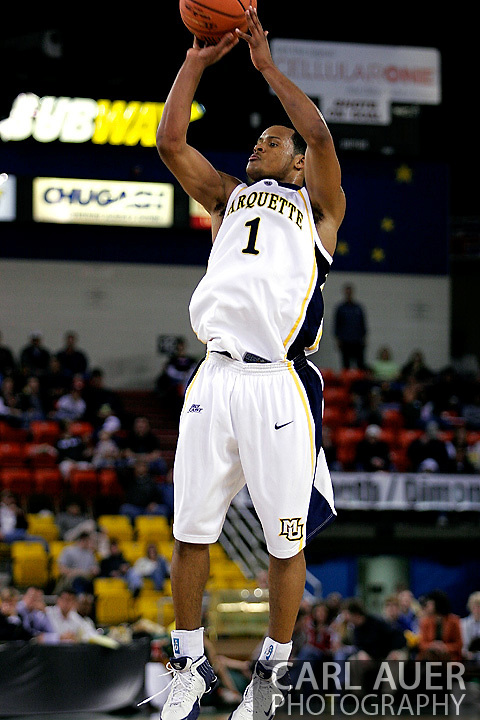 25 November 2005: Marquette Golden Eagle Dominic James (1), a freshman guard, attempts a three point shot in the Marquette University 73-70 victory over Oral Roberts University at the Great Alaska Shootout in Anchorage, Alaska