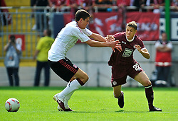 24.07.2010, Fritz-Walter Stadion, Kaiserslautern, GER, 1. FBL, Friendly Match, 1.FC Kaiserslautern vs FC Liverpool, im Bild Ivo ILICEVIC (Kaiserslauern #22 KRO) im Laufduell mit Martin KELLY (Liverpool #2), EXPA Pictures © 2010, PhotoCredit: EXPA/ nph/  Roth+++++ ATTENTION - OUT OF GER +++++