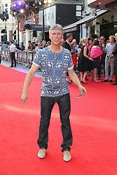 Licensed to London News Pictures. Mark Berry aka Bez, Alan Partridge: Alpha Papa World Film Premiere, Vue West End cinema Leicester Square, London UK, 24 July 2013. Photo credit: Richard Goldschmidt/LNP