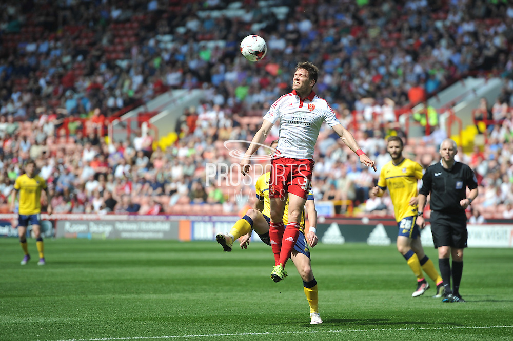 Dean Hammond (35) of Sheffield United heads ball clear of goal area  during the Sky Bet League 1 match between Sheffield Utd and Scunthorpe United at Bramall Lane, Sheffield, England on 8 May 2016. Photo by Ian Lyall.
