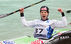 Winner in K1 men Nejc Znidarcic of Slovenia celebrates at final sprint race of European wildwater Canoeing Championships Soca 2013 on May 12, 2013 in Trnovo ob Soci, Soca river, Slovenia. (Photo By Vid Ponikvar / Sportida)