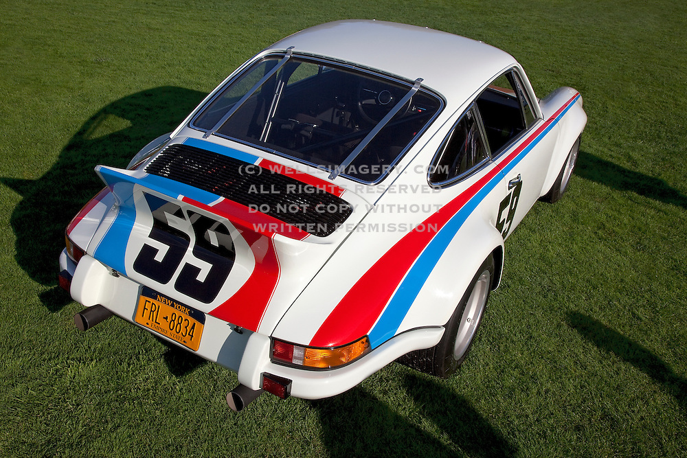 Image of a Brumos Jerry Seinfeld 1973 Porsche Carrera RSR car at the Porsche Race Car Classic, Quail Lodge, Carmel, California, America west coast.