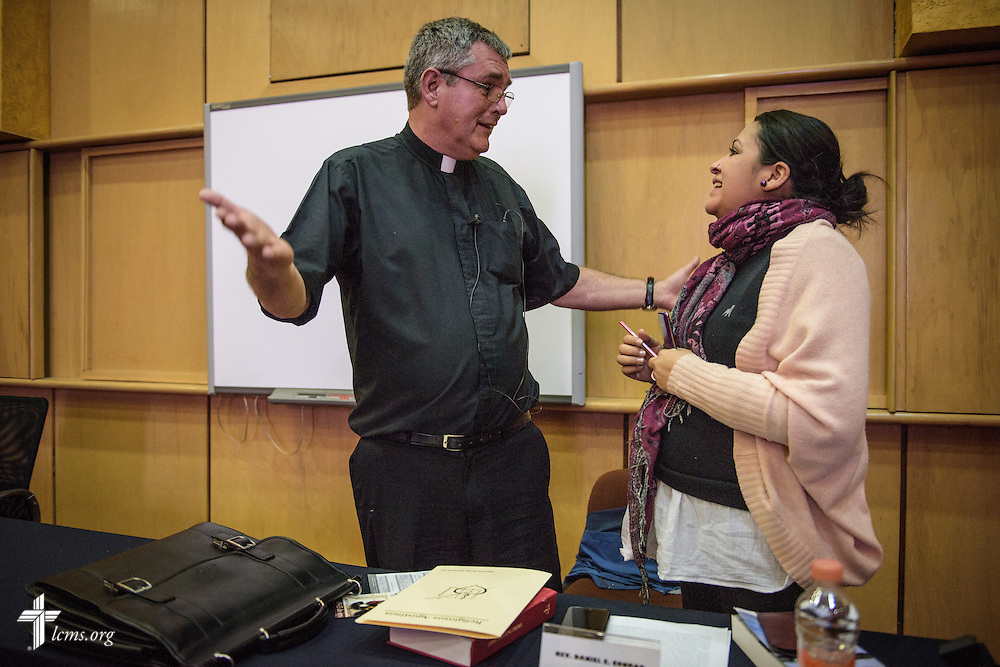 The Rev. Daniel Conrad, LCMS missionary to Mexico, chats with Esperanza Rodriguez following a talk on Lutheranism at a Catholic Augustinian seminary on Friday, Jan. 13, 2017, in Mexico City. LCMS Communications/Erik M. Lunsford