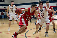 Laconia's Ryan Chandler charges past Plymouth's Zach McGlone during NHIAA Division III basketball Tuesday evening.  (Karen Bobotas/for the Laconia Daily Sun)