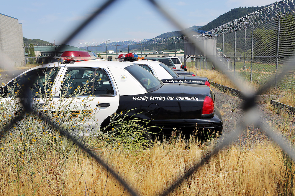 Since federal timber payments have ceased in Josephine County and other parts of Southwest Oregon, the tax-base has shrunk. In Grants Pass, the county seat, shoplifting and other property crime are up, and law enforcement personnel numbers are down. Here, sheriff's office vehicles with no one to drive them are mothballed behind the Josephine County Adult Jail.