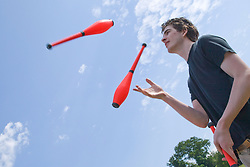 "Juggler throwing skittles into the air at the Nottingham University Student Union ""Sounds on the Downs"" Green Fields Festival; part of Green Week 2008,"