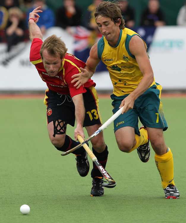 Spain's Ramon Alegre in action against Australia's Jason Wilson in the gold medal match of the Hockey Champions Trophy, Auckland, New Zealand, Sunday, December 11, 2011.  Credit:SNPA / David Rowland