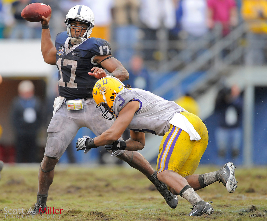 Jan. 1, 2010; Orlando, FL, USA; Penn State Nittany Lions quarterback Daryll Clark (17) looks to throw as he is pressured by LSU Tigers safety Chad Jones (3) during the Nittany Lions 19-17 win in the 2009 Capital One Bowl at the Citrus Bowl. ©2010 Scott A. Miller