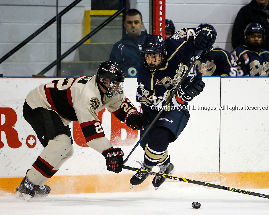 NEWMARKET, ON - Dec 18, 2014 : Ontario Junior Hockey League game action between Toronto and Newmarket, Nick Ursitti #21 skates with the puck past Matt Pyz #22 during the second period.<br /> (Photo by Brian Watts / OJHL Images)