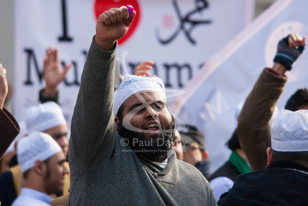"""London, February 8th 2015. Muslims demonstrate outside Downing Street  """"to denounce the uncivilised expressionists reprinting of the cartoon image of the Holy Prophet Muhammad"""". PICTURED: Muslims chant slogans as counter-protesters from Britain First and the English Defence League hurl insults across Whitehall."""