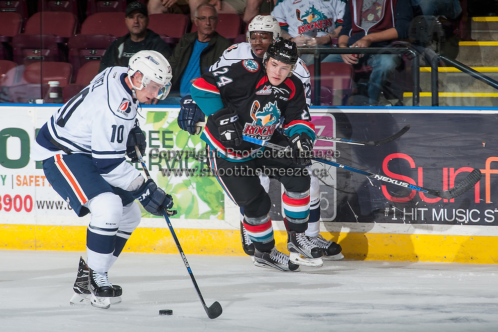 KELOWNA, CANADA - SEPTEMBER 9: Kyle Topping #24 of Kelowna Rockets checks Matt Revel #10 of Kamloops Blazers as he skates with the puck during first period on September 9, 2016 at Prospera Place in Kelowna, British Columbia, Canada.  (Photo by Marissa Baecker/Shoot the Breeze)  *** Local Caption *** Matt Revel; Kyle Topping;