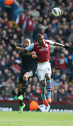 BIRMINGHAM, ENGLAND - Easter Sunday, March 31, 2013: Liverpool's Glen Johnson in action against Aston Villa's Christian Benteke during the Premiership match at Villa Park. (Pic by David Rawcliffe/Propaganda)