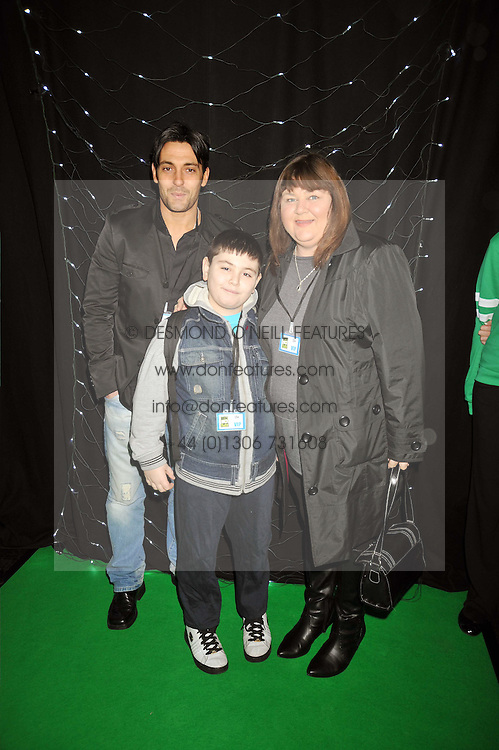 Actress CHERYL FERGUSON and family at the premier of Ben Ten Alien Force at the Old Billingsgate Market, City of London on 15th February 2009.