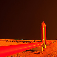 Pipeline transporting liquid natural gas to shipping port in Qatar.