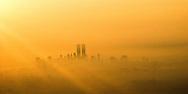 View from airplane at sunrise of World Trade Center, NY, NY