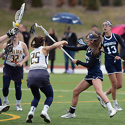 Staff photos by Tom Kelly IV<br /> Episcopal's Lauren Repke (10) shoots and scores past Notre Dame's Julia Damby (25) and goalie Kat Land (00) during the Episcopal Academy at Notre Dame girls lacrosse game on Tuesday afternoon, March 31, 2015.
