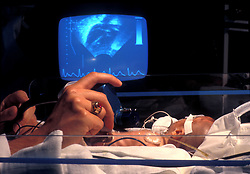 Stock photo of an ultrasound being performed on a newborn.
