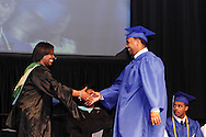 Principal Marlayna A. Randolph prepares to shake hands with graduate Dominick Demus during the Paul Laurence Dunbar High School commencement in the Dayton Convention Center in downtown Dayton, Wednesday, May 23, 2012.