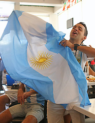June 21, 2018 - Miami Beach, FL, USA - Diego Lucero, a fan of Argentina's national soccer team, shows his support as he watches a television broadcast of the Russia 2018 World Cup match between Argentina and Croatia at Manolo on Thursday, June 21, 2018 in Miami Beach, Fla. Croatia won 3-0. (Credit Image: © David Santiago/TNS via ZUMA Wire)