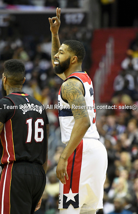 WASHINGTON, DC - APRIL 8: Washington Wizards forward Markieff Morris (5) reacts after making a three point shot against the Miami Heat in the second half on April 8, 2017, at the Verizon Center in Washington, D.C.  The Miami Heat defeated the Washington Wizards 106-103.  (Photo by Icon Sportswire)
