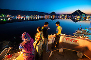 "The Pushkar Lake is surrounded by 52 bathing ghats. Every year on the full moon day in the month of Kartik (October/November), which also happens to be the last day of the world famous ""Pushkar Camel Fair"", Pushkar Lake attracts thousands of pilgrims from all over the country to take a holy dip in its waters. It is believed that a dip in its waters cleanses all the sins and is the surest way to achieve salvation from the cycles of life.<br /> <br /> Prominent among the ghats are Gau Ghat, Brahma Ghat and Varah Ghat. Also called Main Ghat, Gau Ghat is the place from which ashes of Mahatma Gandhi were sprinkled into the lake. Brahma Ghat is believed to be the spot where Brahma himself is said to have worshipped. The Varah Ghat is famed to be the place where Vishnu, the preserver of the Hindu Trinity, appeared in the form of Varaha (a boar), third in the line of his nine incarnations."