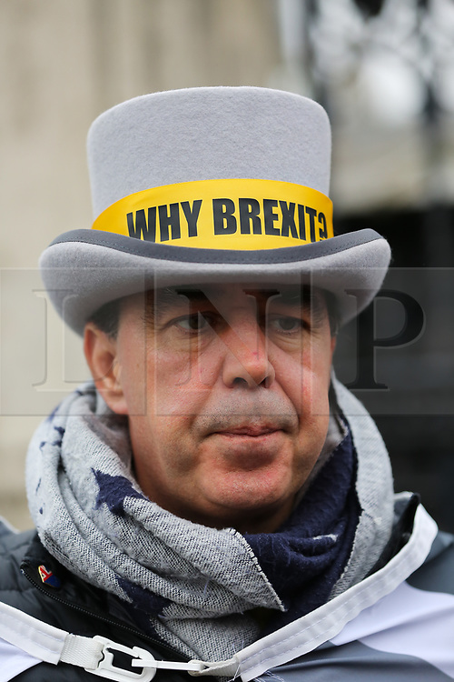 © Licensed to London News Pictures. 22/01/2020. London, UK. Pro-European campaigner Steve Bray wearing a hat with 'Why BREXIT' sign written on it as anti-Brexit campaigners demonstrate outside Houses of Parliament with nine days to  Brexit Day. Photo credit: Dinendra Haria/LNP