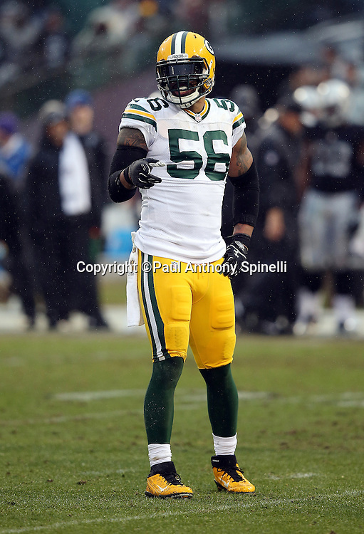 Green Bay Packers outside linebacker Julius Peppers (56) points during the 2015 week 15 regular season NFL football game against the Oakland Raiders on Sunday, Dec. 20, 2015 in Oakland, Calif. The Packers won the game 30-20. (©Paul Anthony Spinelli)
