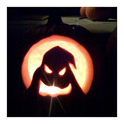 Oogie Boogie carved in a pumpkin.