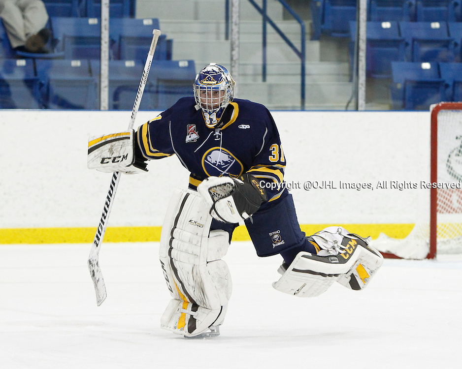 OAKVILLE, ON - Sep 28, 2014 :  Ontario Junior Hockey League game action between Wellington and Buffalo at the Governor's Showcase Tournament. Goaltender Alex Connal #31 of the Buffalo Junior Sabres Hockey Club skates to the bench on a penalty call during the first period.<br /> (Photo by Tim Bates / OJHL Images)