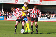 Kyle Storer, Alan Power and Jack Barthram  during the Vanarama National League match between Cheltenham Town and Lincoln City at Whaddon Road, Cheltenham, England on 30 April 2016. Photo by Antony Thompson.