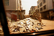 Discarded computer keyboards lie in a pile in the street in an area where much of the world's electronic waste _ from cell phone chargers to mainframe computers _ ends up in Guiyu and other small towns like it in eastern China, Thursday March 16, 2006. Workers, many of them poorly paid migrants strip, smash and melt down circuit boards, mainly to extract the copper and other precious metals inside.The business has created massive pollution from leaded glass and other toxic materials. Such pollution could be mitigated by moves to recycle and properly dispose of so-called electronic waste that are gaining ground in the West.