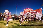 23 SEPTEMBER 2011 - SCOTTSDALE, AZ: The Desert Mountain football team takes the field at Desert Mountain High School in Scottsdale. Desert Mountain played Notre Dame in Desert Mountain's homecoming high school football game.     PHOTO BY JACK KURTZ