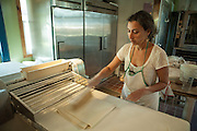 Jamestown, RI - 7 May 2007. Dorianna Carella, co-owner of The Village Hearth Bakery and Cafe, rolling puff pastry.