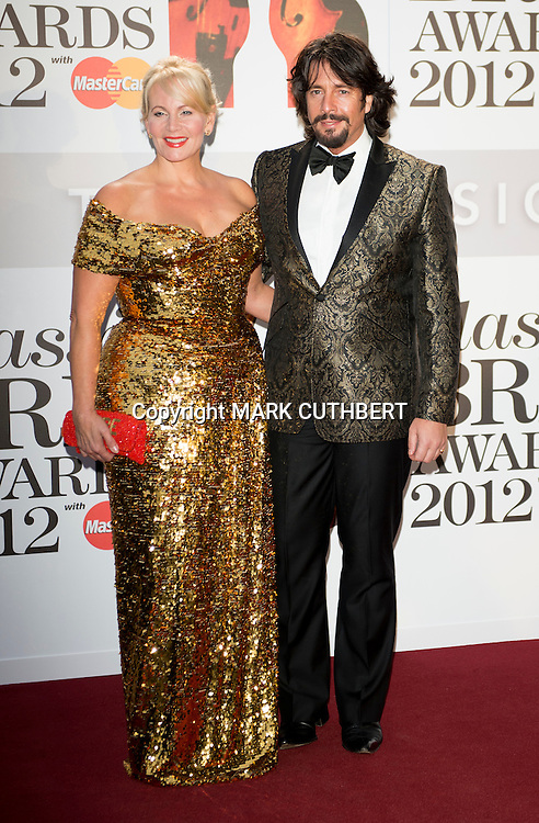Laurence Llewelyn-Bowen and Jackie Llewelyn-Bowen arriving at the 2012 Classic Brit Awards at the Royal Albert Hall in London.
