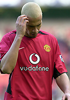Photo: Greig Cowie<br />Barclaycard Premiership. Manchester United v Manchester City. 09/02/2002<br />Rio Ferdinand scratches his head as he leaves the field