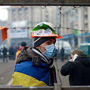 December 19, 2013 - Kiev, Ukraine: A pro-EU demonstrator guards an access to the Independence Square.<br /> On the night of 21 November 2013, a wave of demonstrations and civil unrest began in Ukraine, when spontaneous protests erupted in the capital of Kiev as a response to the government&rsquo;s suspension of the preparations for signing an association and free trade agreement with the European Union. Anti-government protesters occupied Independence Square, also known as Maidan, demanding the resignation of President Viktor Yanukovych and accusing him of refusing the planned trade and political pact with the EU in favor of closer ties with Russia.<br /> After a days of demonstrations, an increasing number of people joined the protests. As a responses to a police crackdown on November 30, half a million people took the square. The protests are ongoing despite a heavy police presence in the city, regular sub-zero temperatures, and snow. (Paulo Nunes dos Santos/Polaris)