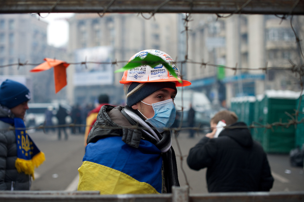 December 19, 2013 - Kiev, Ukraine: A pro-EU demonstrator guards an access to the Independence Square.<br /> On the night of 21 November 2013, a wave of demonstrations and civil unrest began in Ukraine, when spontaneous protests erupted in the capital of Kiev as a response to the government's suspension of the preparations for signing an association and free trade agreement with the European Union. Anti-government protesters occupied Independence Square, also known as Maidan, demanding the resignation of President Viktor Yanukovych and accusing him of refusing the planned trade and political pact with the EU in favor of closer ties with Russia.<br /> After a days of demonstrations, an increasing number of people joined the protests. As a responses to a police crackdown on November 30, half a million people took the square. The protests are ongoing despite a heavy police presence in the city, regular sub-zero temperatures, and snow. (Paulo Nunes dos Santos/Polaris)