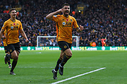 Ruben Neves of Wolverhampton Wanderers scores and celebrates the first goal of the game during the Premier League match between Wolverhampton Wanderers and Aston Villa at Molineux, Wolverhampton, England on 10 November 2019.