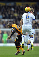 Liam Cooper of Leeds United makes his presance felt on Sone Aluko of Hull City during the Sky Bet Championship match at Elland Road, Leeds<br /> Picture by Graham Crowther/Focus Images Ltd +44 7763 140036<br /> 05/12/2015