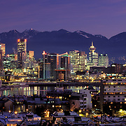 Canada, Vancouver, BC; Skyline At Sunrise;  False Creek & Condos In Foreground With Coast Range Mountains In Distance