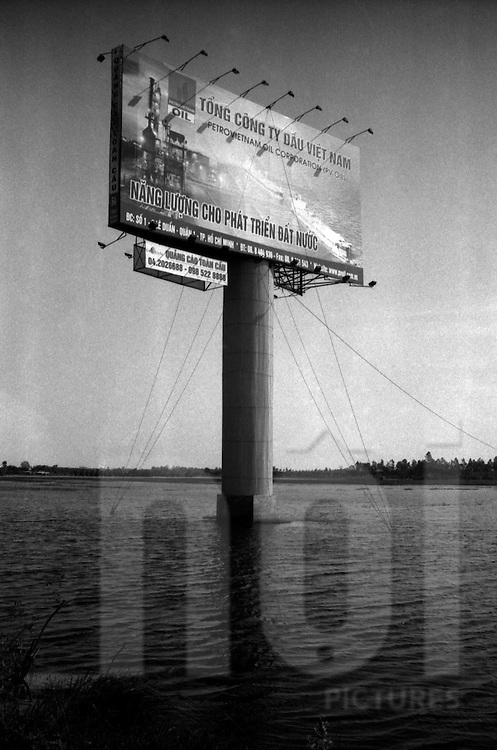 Hanoi, Vietnam.2008.Flooded Advertisement billboard on The road to Noi Bai airport