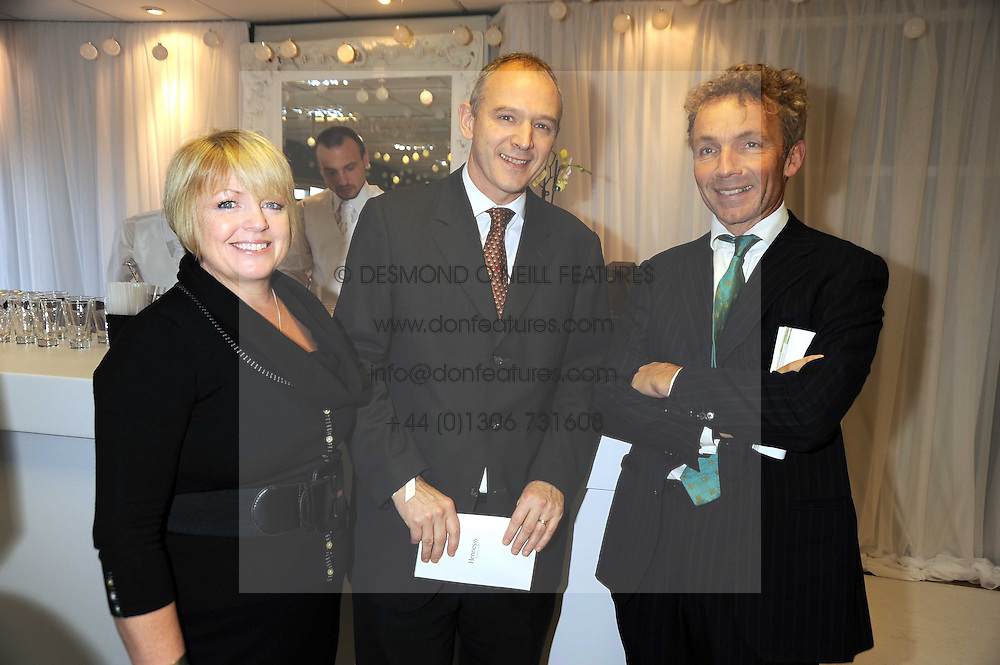 Left to right, GRAHAM & MICHELLE BOYES and JOHNNY FRANCOMBE at the 2008 Hennessy Gold Cup held at Newbury racecourse, Berkshire on 29th November 2008.<br /> <br /> NON EXCLUSIVE - WORLD RIGHTS