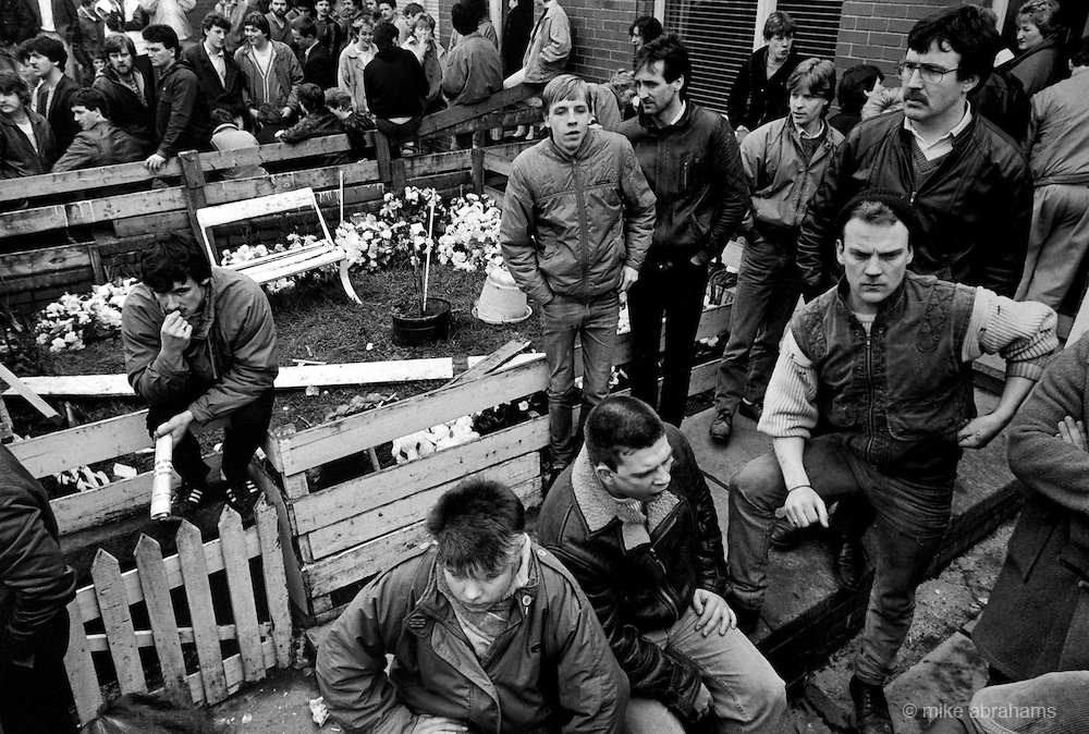 Mourners gather outside the home of Lawrence Marley who was assasinated by loyalist gunmen at his home. Ardoyne, Belfast 1987. Northern Ireland