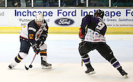 16 Jan 2010: Guildford, England. Adrian Saul (12) of Guildford Flames attempts to pass Tony Hand MBE (9) of Manchester Phoenix during the English Premier League match between Guildford Flames  Manchester Phoenix at Guildford (photo by Andrew Tobin/Slik Images)